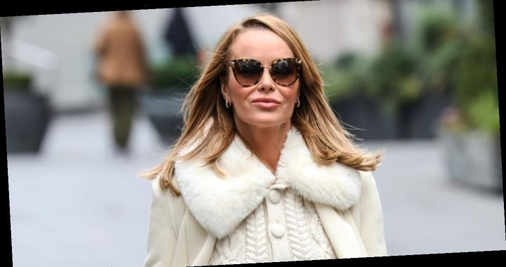 Amanda Holden oozes glamour as she steps out in cream ensemble with fur collar and cable knit cardigan