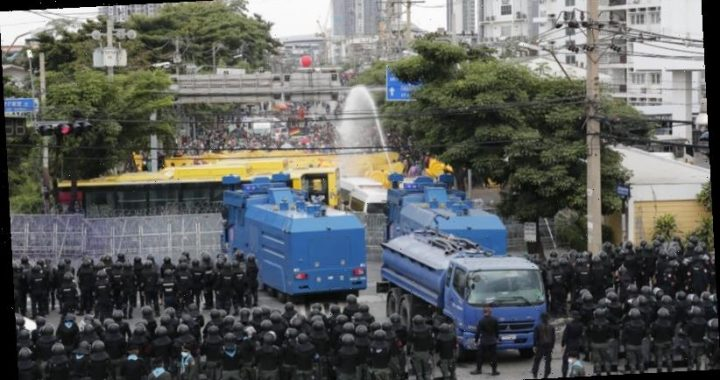 Thailand police fire water cannon at Parliament protest