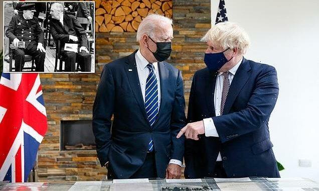 Boris Johnson and Joe Biden look at the original Atlantic Charter