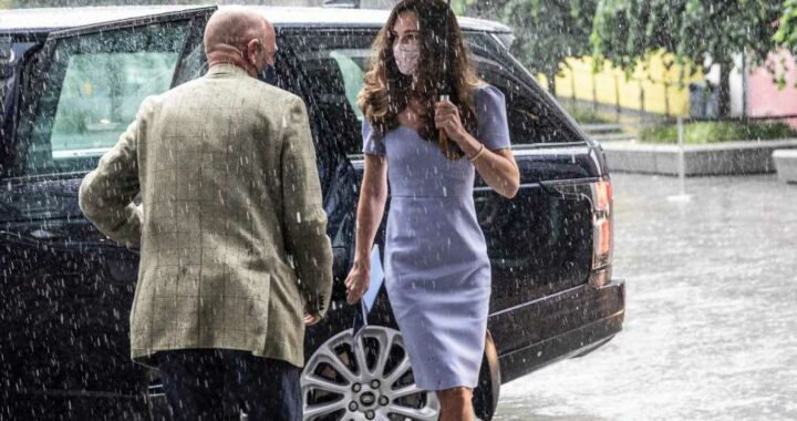 Kate Middleton stuns as she dashes through the rain after calling for a 'happier' society with research centre launch