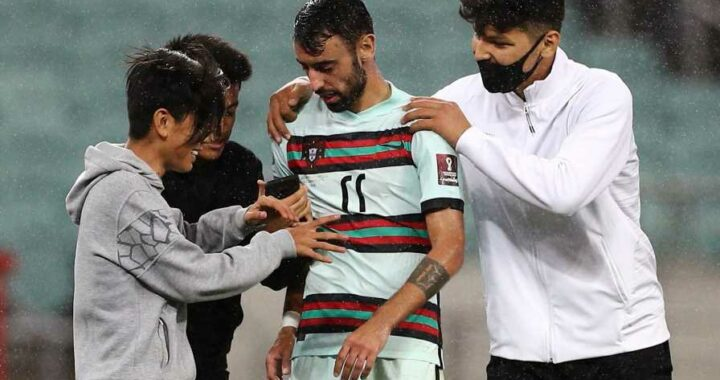 Fans invade pitch to take selfies with Man Utd star Bruno Fernandes during Portugal's clash with Azerbaijan in Baku