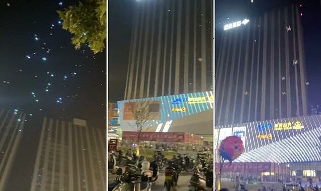 Pedestrians run for cover as drones fall from sky during light show